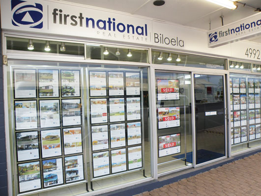 First national real estate displays for Real estate office wall decor